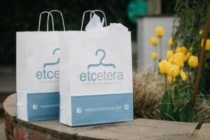 Etcetera branded paper bags